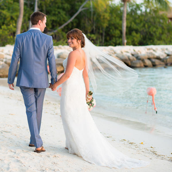 newlyweds with flamingos