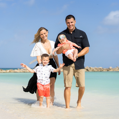 family beach photo in aruba
